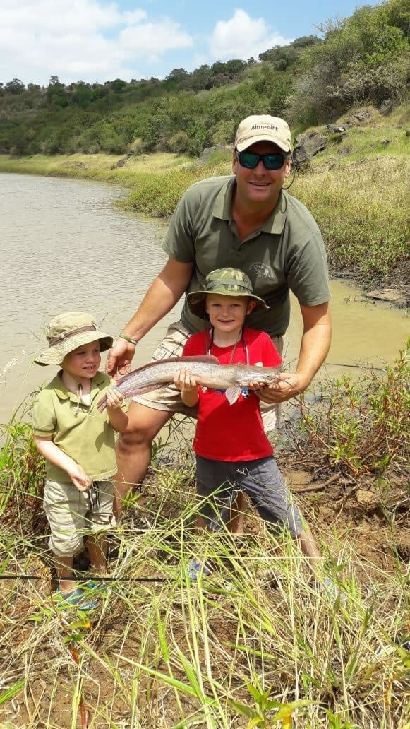 General Manager and head of our team Sean Outram with his sons, holding a fish