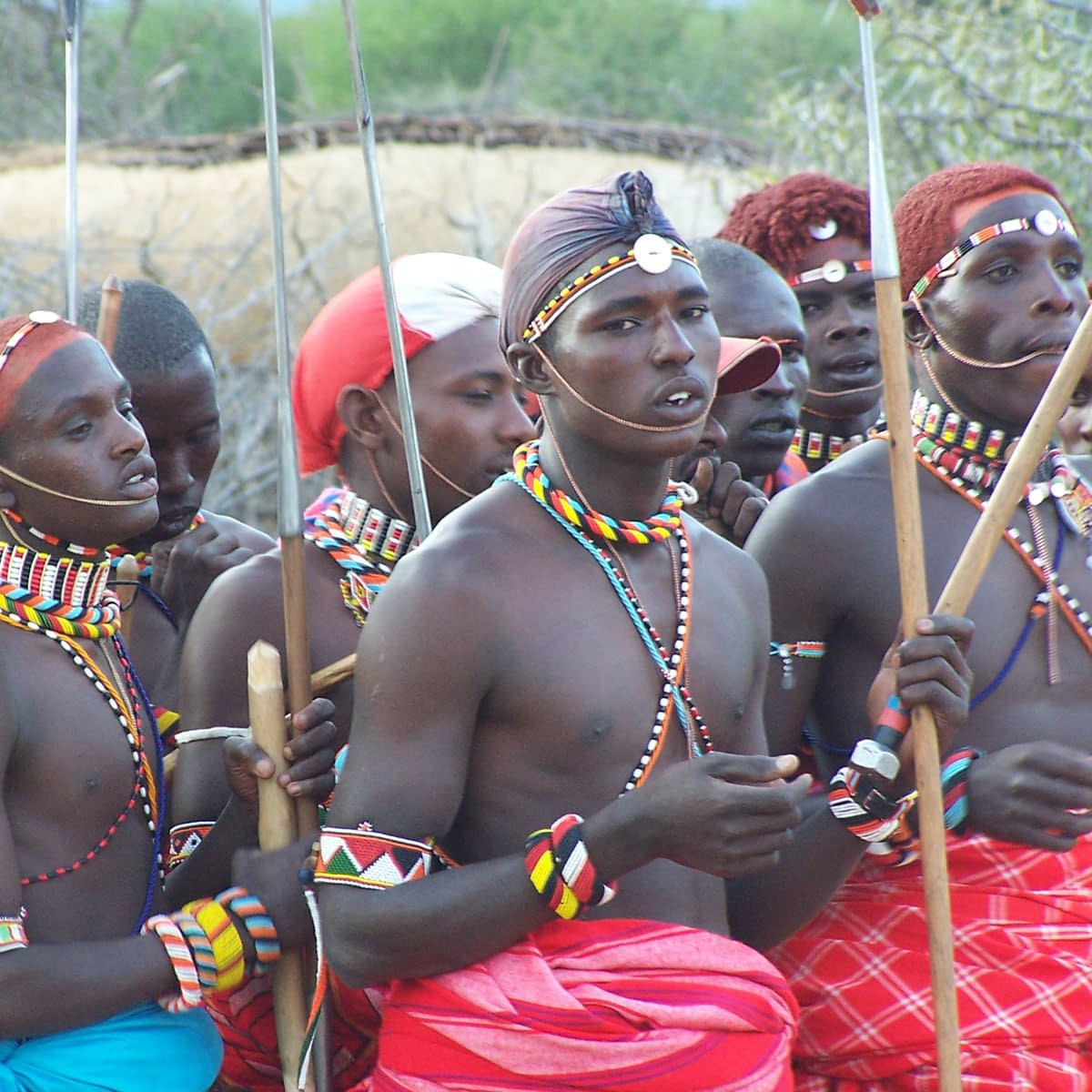 Male Samburu tribesmen in tradition red and blue clothing with woven accessories