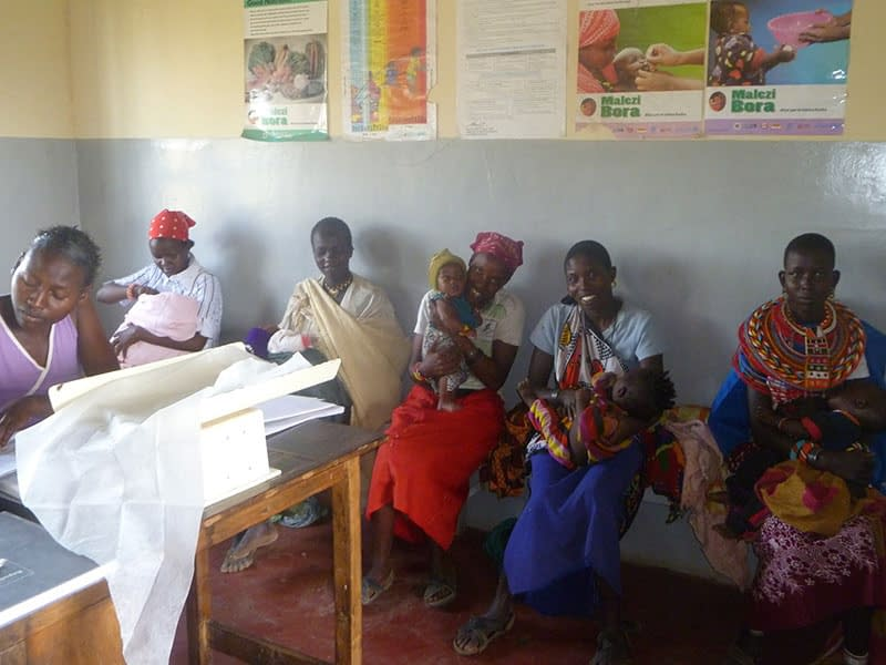 Mothers and Babies sat in the waiting area at the health clinic