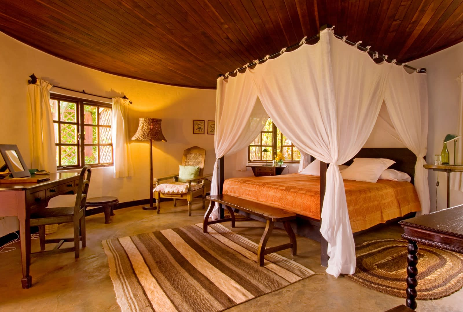 A Grand 4-poster bed in The Italian Cottage at Sosian Lodge